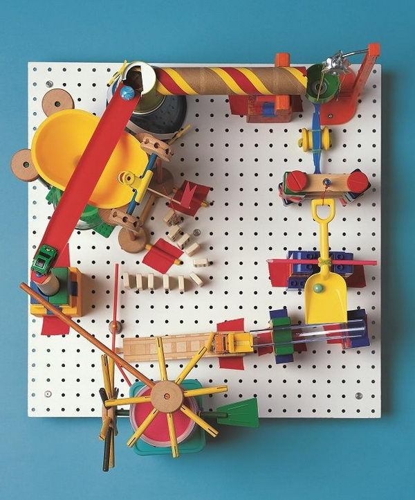 DIY Marble Run Craft, This peg-board marble run involves creating a clacking, whacking gumball machine that runs without electricity, all with parts found in the kitchen and toy box. A complete operation tutorial was provided.