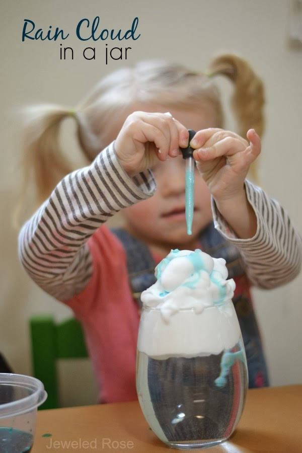 Rain Clouds in a Jar Science Project. Fill the jars or containers with water and then top with shaving cream. Fill their pipettes or droppers with blue water and squeeze it onto their cloud. As the cloud fills with water it will begin to rain.