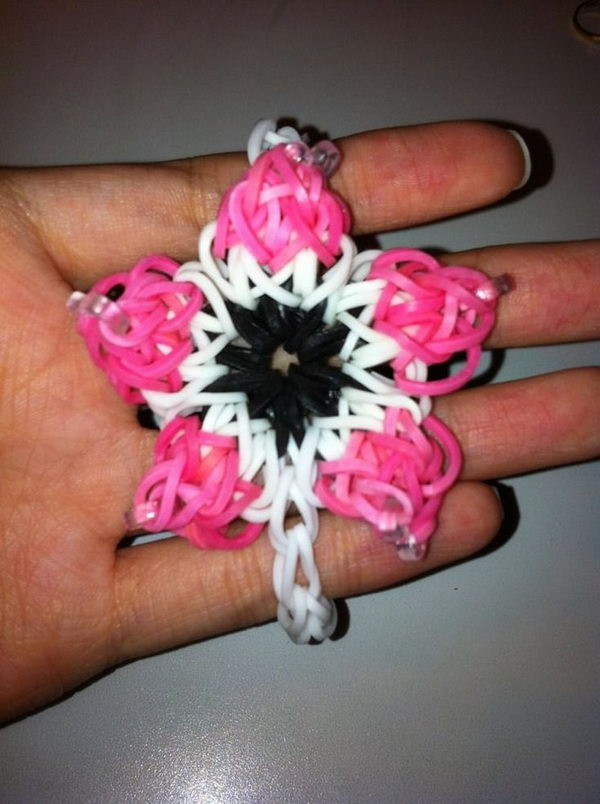 Flower Rainbow Loom Bracelet. Rainbow Loom is one of the top gifts for kids, and every kid seems to have at least one piece of rubber band jewelry.