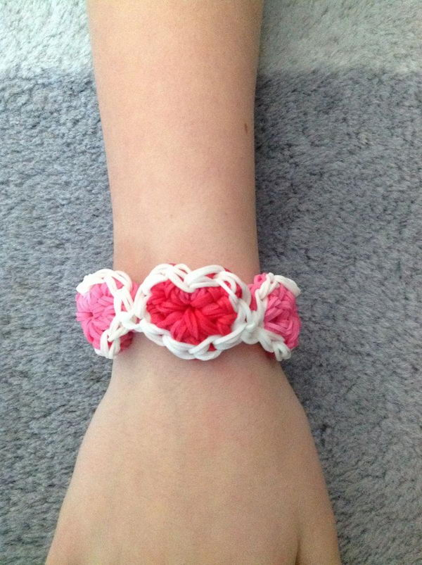 Heart Rainbow Loom Bracelet. Rainbow Loom is one of the top gifts for kids, and every kid seems to have at least one piece of rubber band jewelry.
