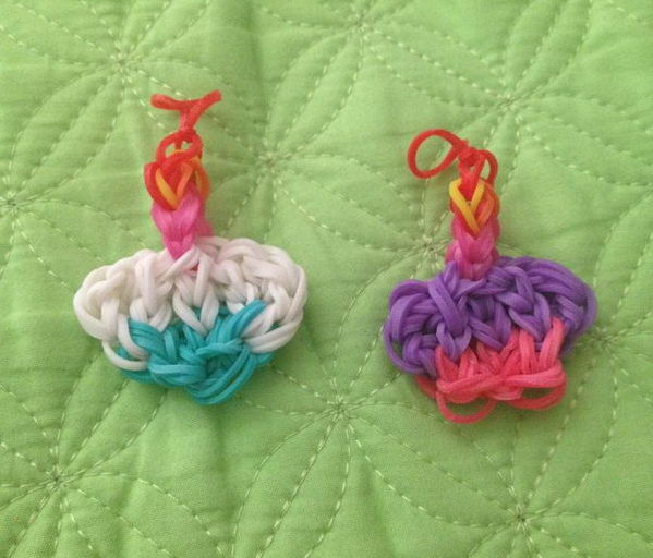 Cupcake Rainbow Loom Charms. Rainbow Loom is a plastic loom used to weave colorful rubber bands into bracelets and charms. It is one of the top gifts for kids.