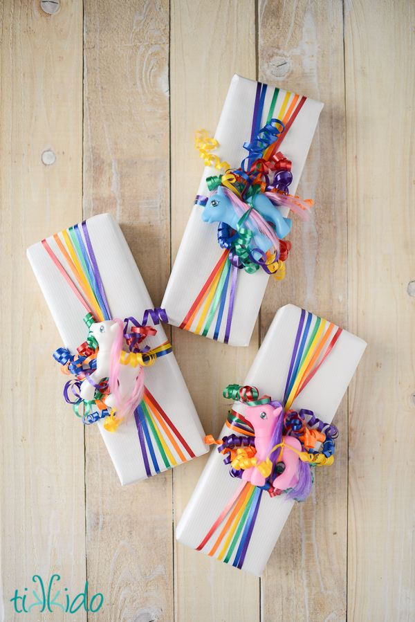 Easy Rainbow Ribbon Gift Wrap. Rainbow colors are perfect for a festive event, from kids or adult birthdays to anniversaries or graduation.