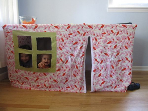 A playhouse under the table. Great idea to bring the fun indoors.