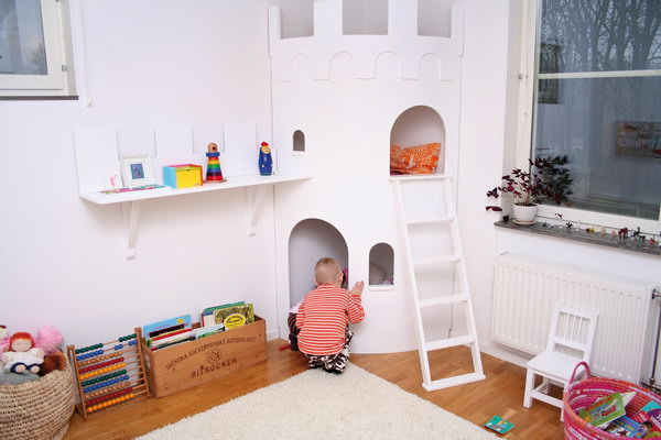 Castle playhouse for kids. Great idea to bring the fun indoors.