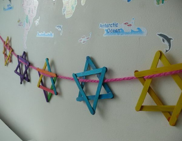 String the popsicle star of David together for Hanukkah decoration.