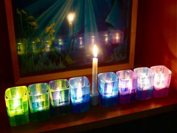 This colorful Hanukkah menorah is made from glass tea light holders and colored tissue paper. It is great for small spaces, and crafts up very quickly.