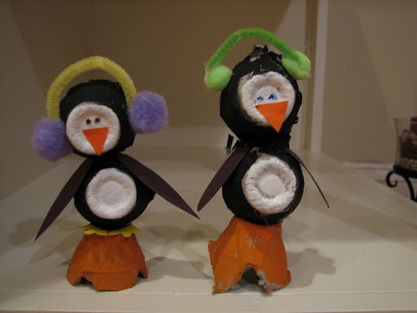 Create penguin crafts for your kids with egg cartoons and pom poms.