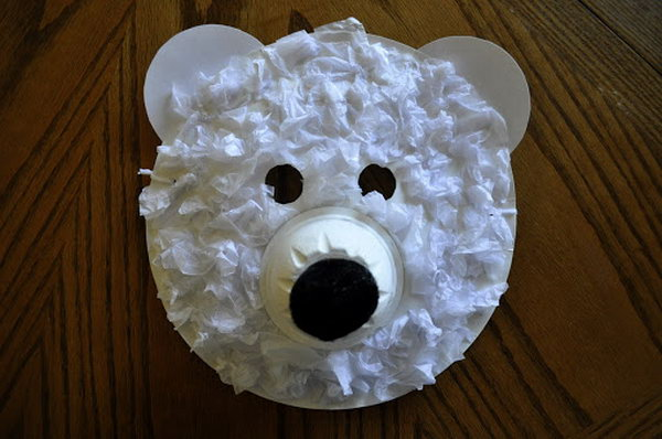 Polar bear mask made with paper plate, tissue paper and paper cup.