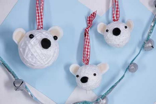 See how to put together the polar bear ornaments with styrofoam balls, yarn, and pom poms.