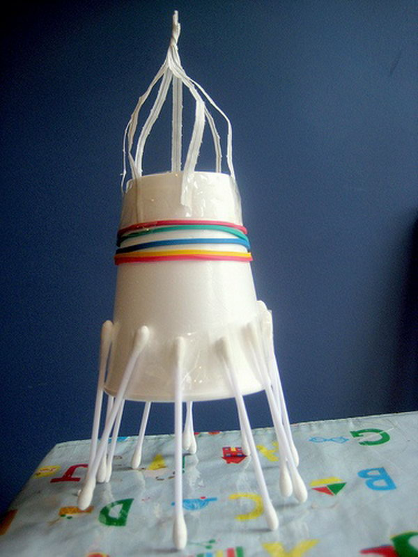 Junk model space rocket made from paper cup and cotton swabs.
