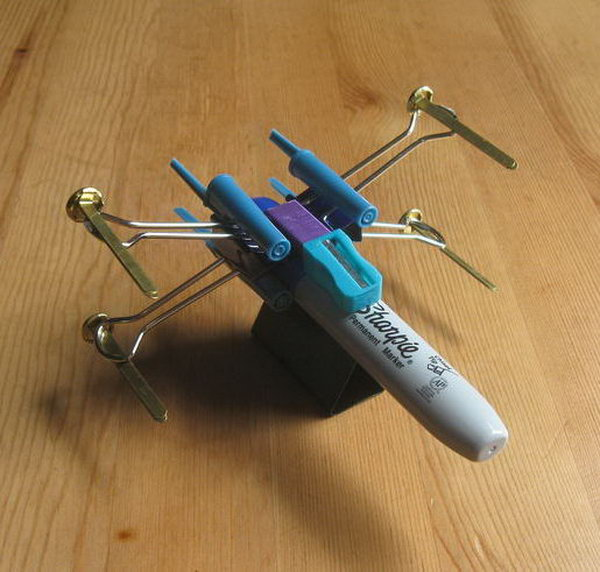 Do you remember the X Wing Fighter in Star Wars? This cool X Wing Fighter is made from office supplies.