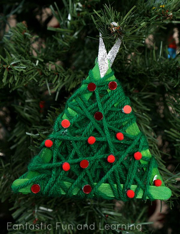 Make these yarn wrapped Christmas tree ornaments with kids and place them on your Christmas tree.