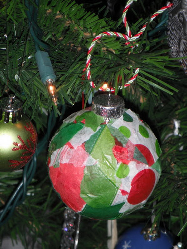 Glass ornament with Christmas colored tissue paper glued onto the outside. So simple, yet so cute and frestive.