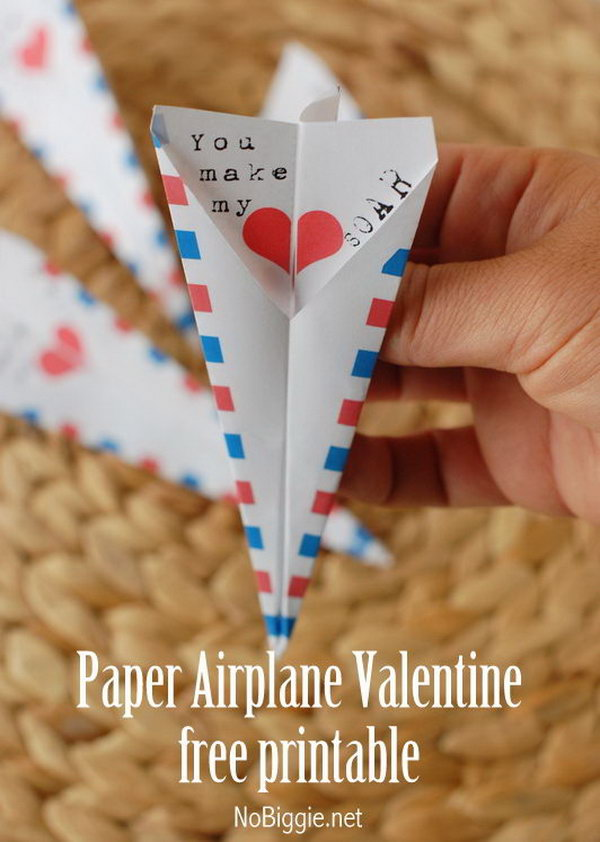 Paper airplane Valentine. A double sided paper airplane that reads 'You make my heart SOAR'.