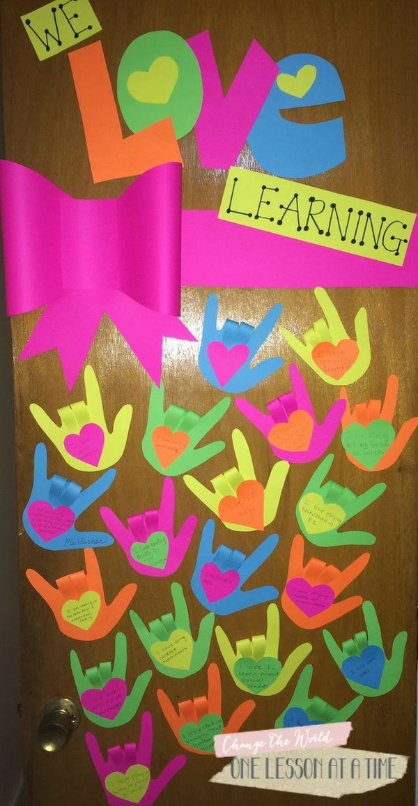 We love learning: Each student create a hand that shows the sign for I Love You and fill out something they love.