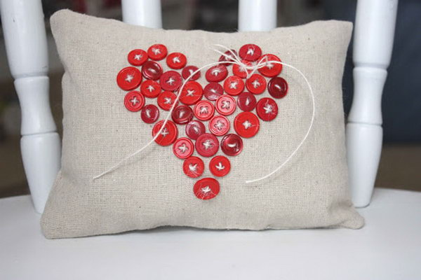 Decorate your pillow with a button heart shape.