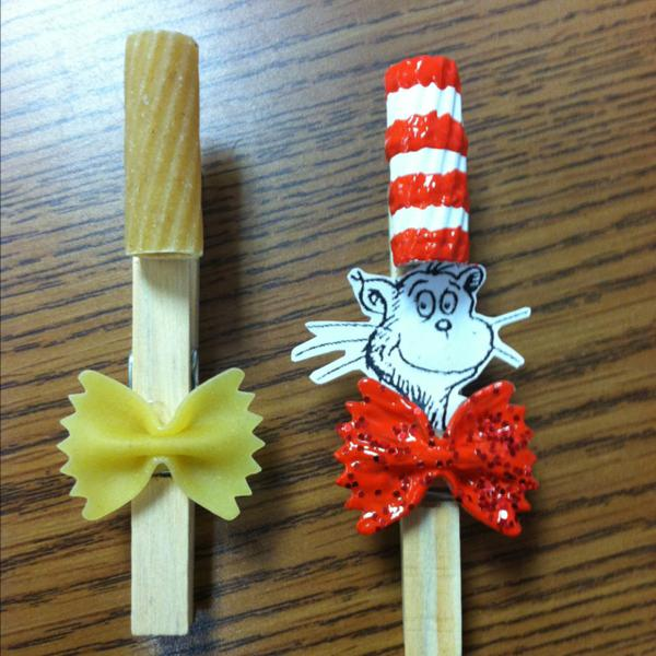 Clothespin craft inspired by Dr. Seuss' book The Cat in the Hat. It provides kids with a fun way to display papers and projects on the refrigerator at home or on a school bulletin board.
