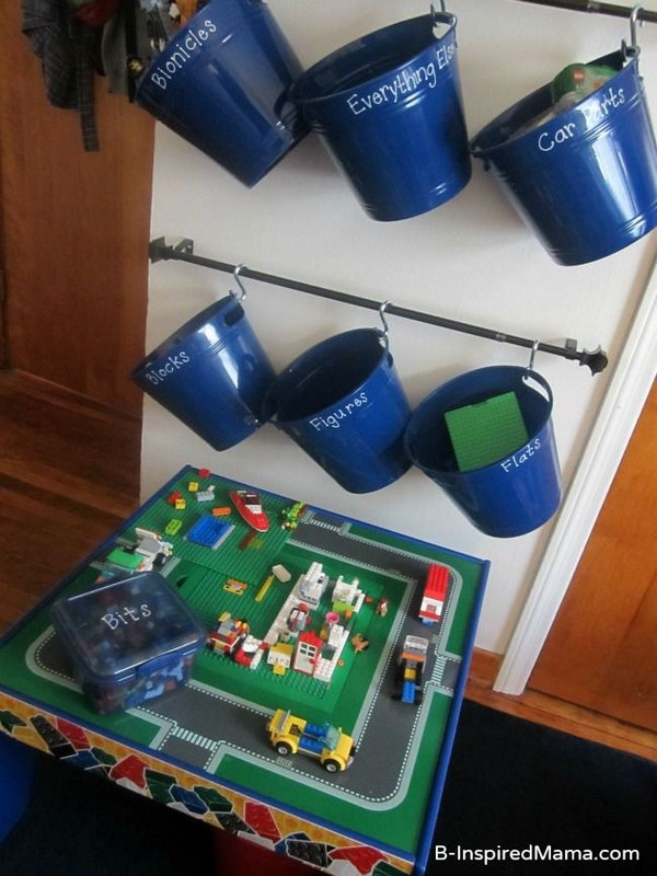 Hanging wall LEGO storage system made from curtain rods, hooks and plastic buckets. It's easy for kids to see everything and take down and put back his buckets by himself.