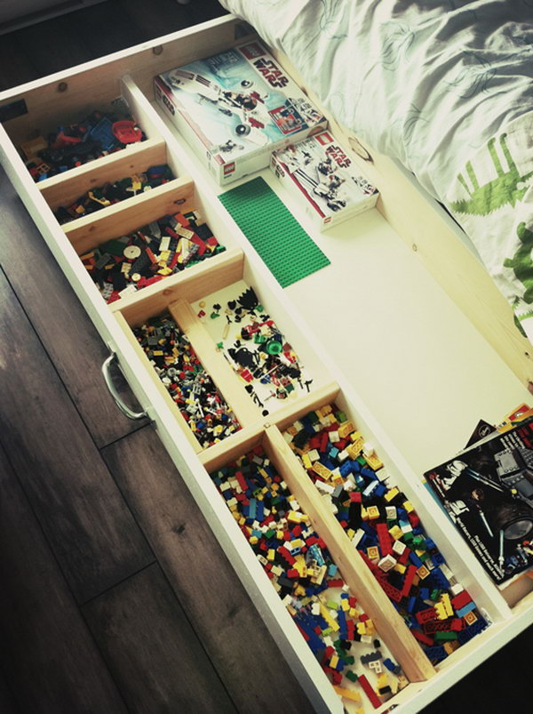 Built a Lego storage unit on casters to roll under the bed.