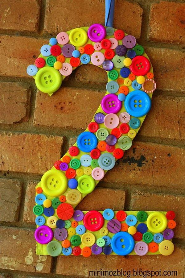 Rainbow Colored Button Number. A cute party decorating idea for kids. Perfect for a festive event to anniversary or graduation.