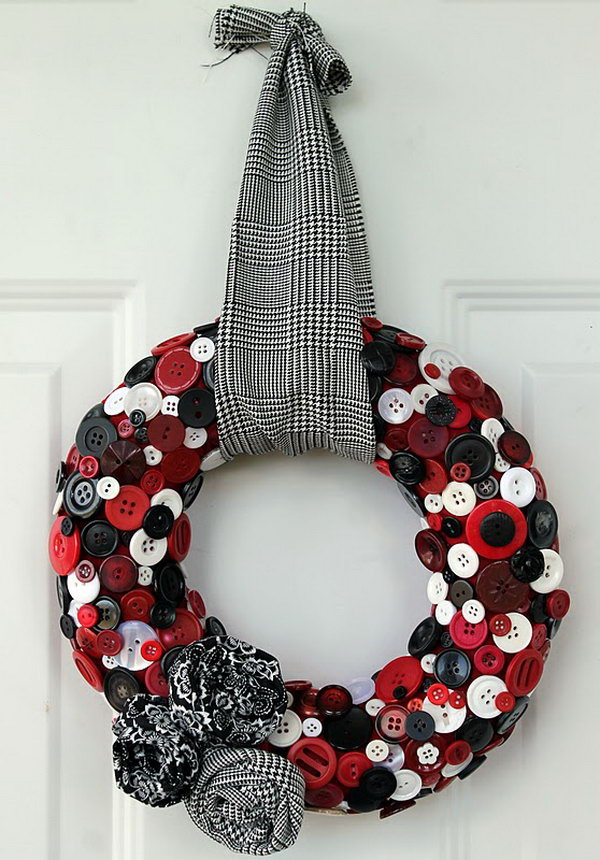 Upcycled Button Wreath. A cute wreath made from a bunch of colored buttons and decorated with matching fabric flowers.
