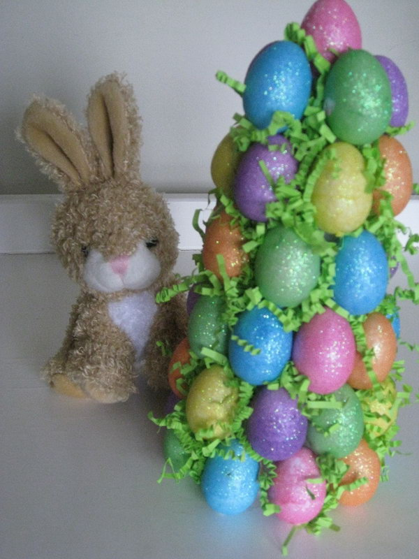 Easter Egg Tree. Stick colorful egg ornaments at a Dollar Tree. It's a fun craft to do with the kids and one that you can use every year.