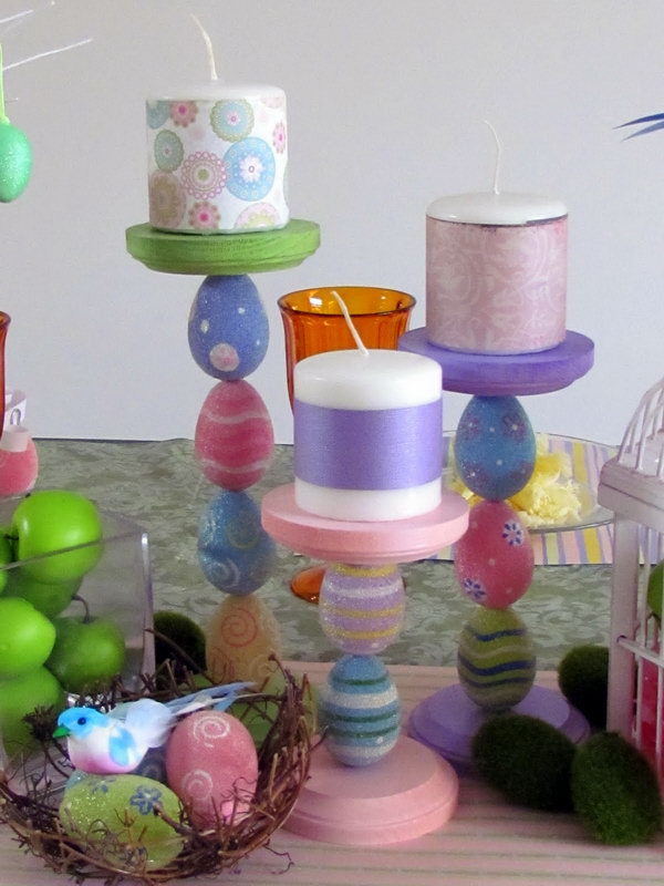 Colorful Easter Candle Holders. Use plastic eggs, wood candlesticks and dowel rods to create some adorable egg Candlesticks. Bunch together on your Easter Tablescape with some pretty candles and decorate your house on a budget.