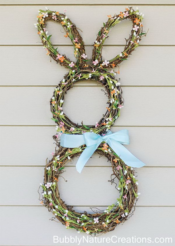 Easter Bunny Wreath. Celebrate the spring season and Easter with the homemade Easter Bunny Wreath. The green leaves, little flowers, ribbon accessories and cute bunny shape are sure to please everyone.