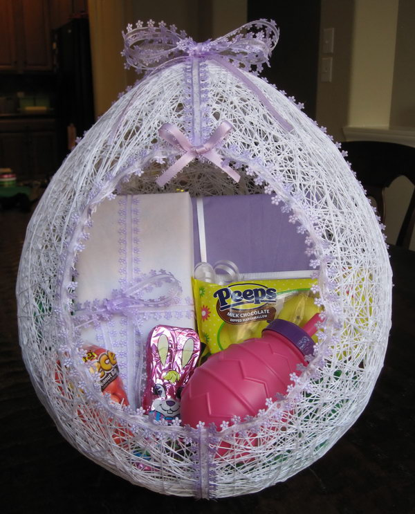 Egg Shaped Easter Basket Made from String. Create this fun and colorful Easter baskets with your kids to hold their gifts and collect their treasures during Easter egg hunts.