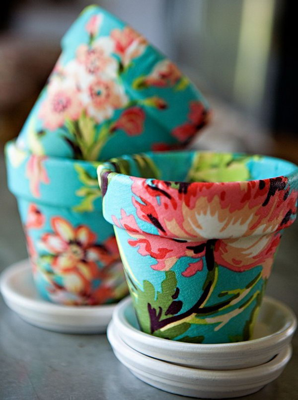 Mod Podge on Terra Cotta with Fabric. Grab some pretty fabric and Mod Podge to cover a flower pot bought at a garden center. A cute last minute gift idea.