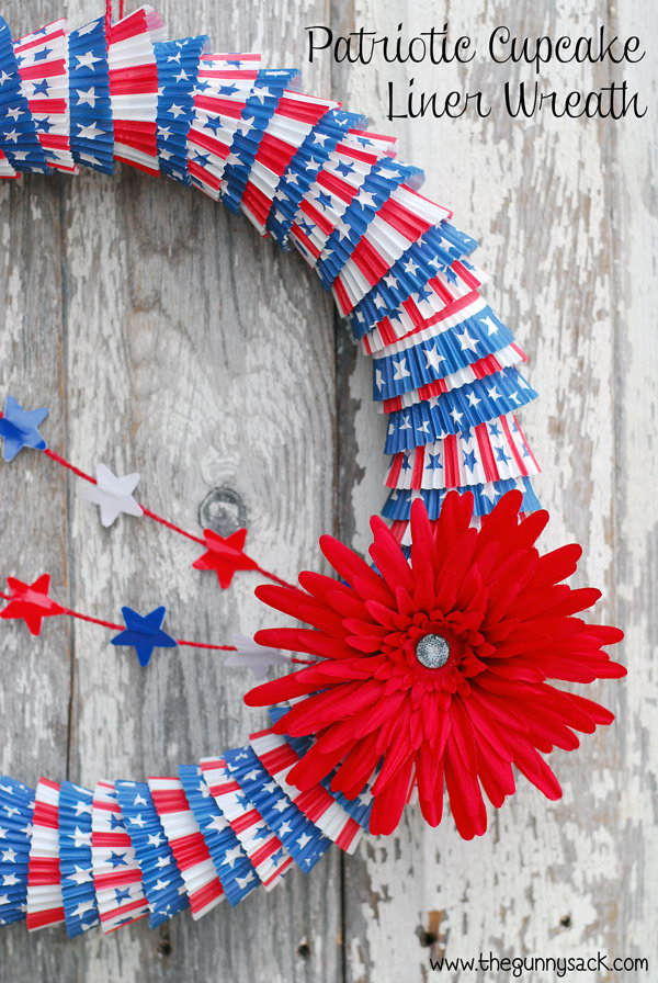 A patriotic cupcake liner wreath in red, white and blue that can be used for both Memorial Day and the 4th of July.