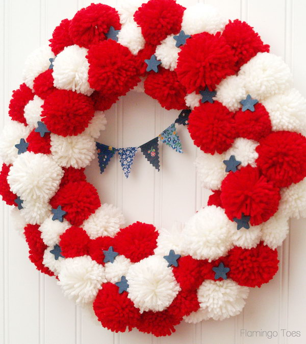Patriotic Pom Pom Wreath for 4th of July or Memorial Day. The pom pommyness of this wreath is so cute. A great idea for all the summer holidays.