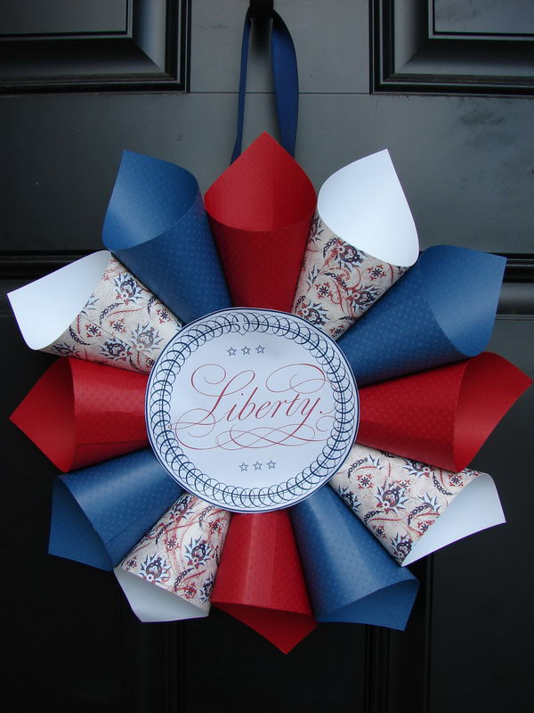 Patriotic Paper Cone Wreath. DIY Fourth of July Wreath made out of colored red, white and blue patterned papers.