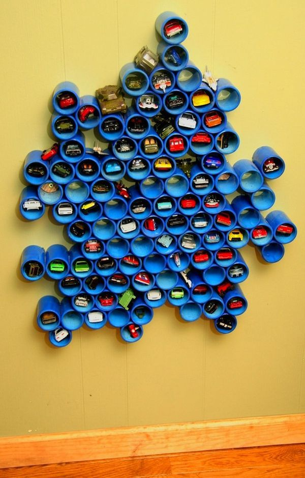 PVC Pipe Toy Storage. A creative way to store all those Hot Wheels cars. It make an artsy design on the wall that acts not only as storage but some stylish texture as well.