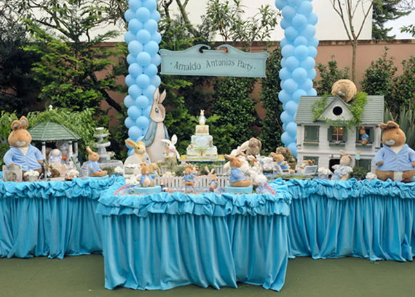 This Peter Rabbit themed party is awesome. Look at the birthday cake and wonderful truffle wrappers all around. The rabbits family, the houses, balloons,cakes and other decorations brings the children to a fairy tale world.