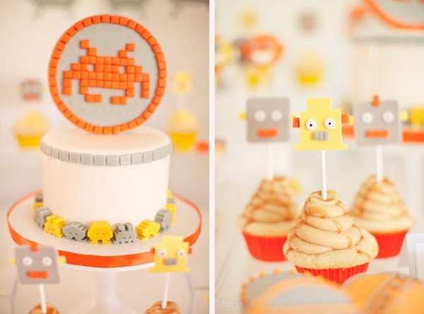 This cheery yellow, orange and grey space invaders themed birthday party was deeply impressive. Even the flower arrangements wear antennas! And they were so cute.