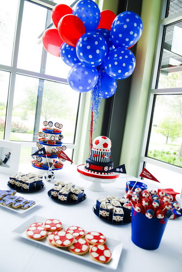 Boys usually love soccer. This party has lots and lots of soccers: cute soccer lollipops, three layer cake with a big soccer topper, soccer bags, cute soccer tags, soccer shaped crackers.