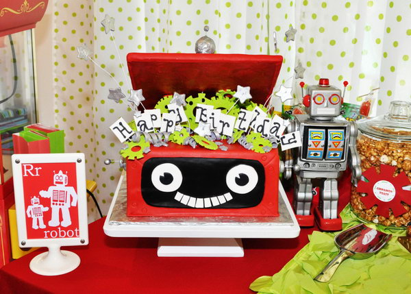 I love every single detail of this robot and rocket themed cake. The themed treats like the robots and the red robot cards in the frame are great too.