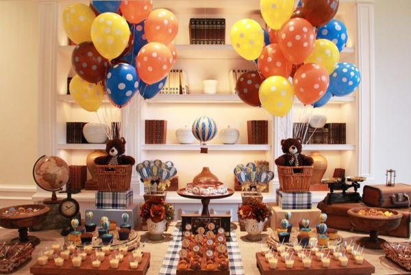 The party has everything babies loves. Lots of hot air balloons in bright colors, the teddy bears, the globe, the counter balance,many cupcakes, and more to look at. Hot air balloons usually symbolize growing or going up. What a great way to display the wishes to your loved child.