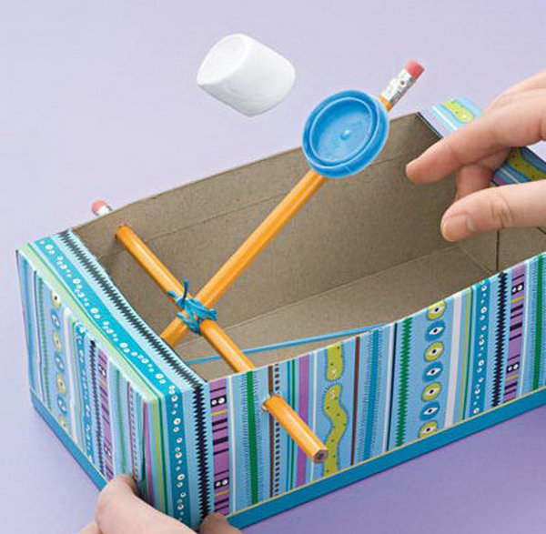 Recycled Shoe Box Catapults. Shoe boxes lying around your house are not just trash. Instead of just throwing them away, you can reuse them in fun crafts and convert them into a fun toy for you lovely kids just with 2 pencils, a rubber band, and a milk cap. Learn how to do it.