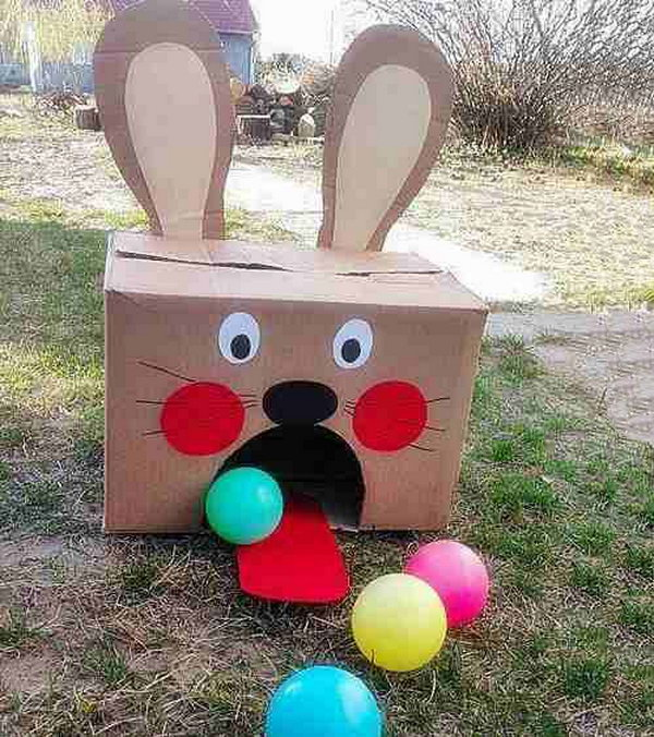 Easter Bunny Ball Toss Activity. Use a huge carton-box and make it into the Easter bunny shape. Leave a big fan-shaped hole and glue its tongue from red-painted cardboard. Stand five feet from the Easter Bunny carton and throw colorful balls toward it. Count how many balls you can throw in.