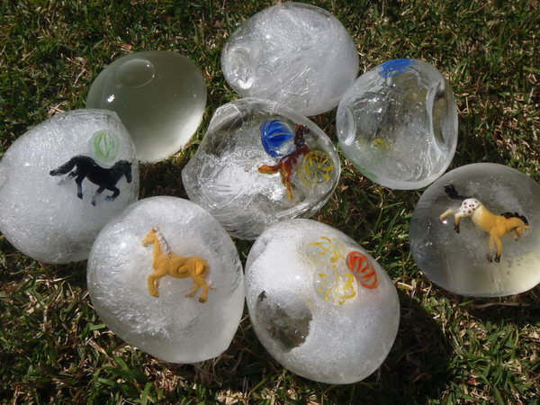 Ice Easter Eggs. Place some crafts or glass stones in the balloon, fill it with water using the tap, tie it off and place it in the freezer overnight. You will get this beautiful ice egg. It's very interesting to retrieve the treasure inside by cracking the eggs open.