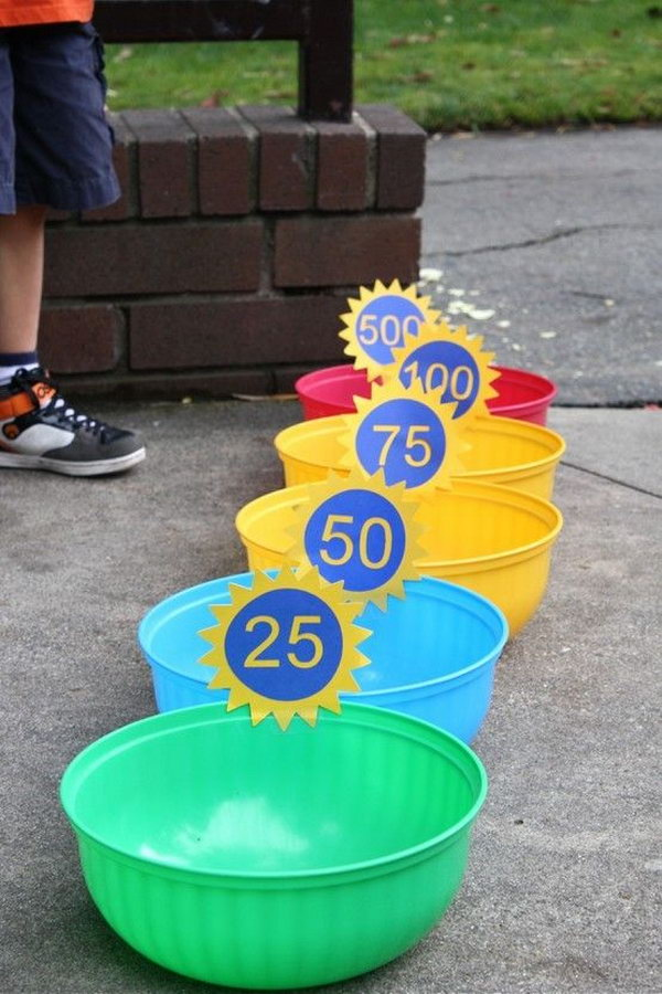 Bean Bag Toss. There are six bean bags and the members take turns throwing them into the bowls. Try to get more points!