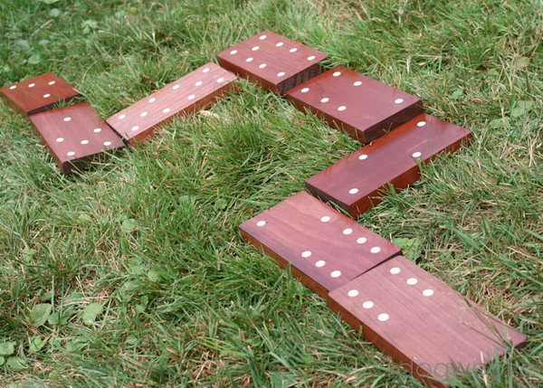 Dominoes. These life-sized dominoes made from wooden boards and stickers will provide fun for hours, and you've got a summer of fun.