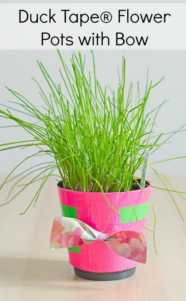 Duck Tape Flower Pots with Bow. What a great way to dress up the standard pot plants. This would make for a great DIY Mother's Day gift idea.