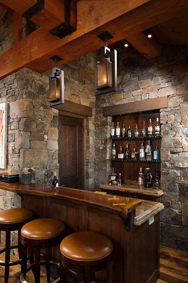 Rustic home bar design. The home bar has become one of the typical rooms in homes today. Rich wood, leather chairs,stone wall are popular in the modern day life.