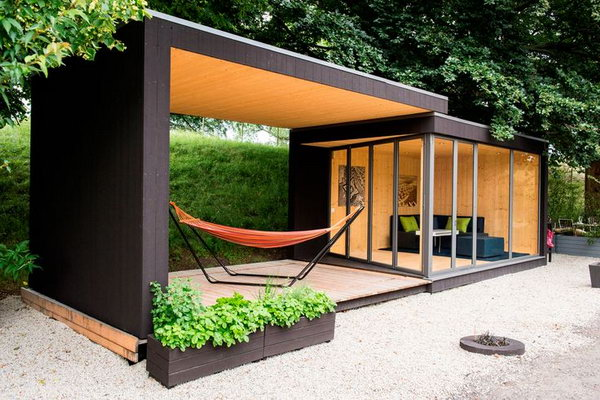Backyard room. A new prefab house takes your outdoor backyard space and turns it into an office or guest cottage with a movable roof.