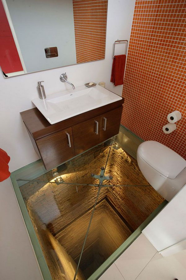 Glass floor bathroom. Having a bathroom like this will literally scare you, but it's also stimulating. If you a brave man ,you can get one .