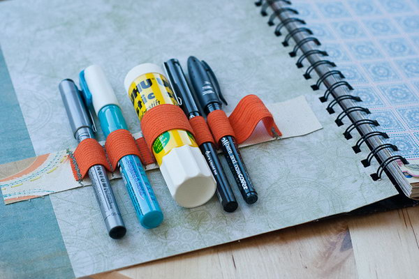 Supply Holder Notebook. Stick a pocket and fill it with journaling pieces. Secure orange elastic on the outside cover with a set of towels to make it more applicable to keep your essentials tidy.