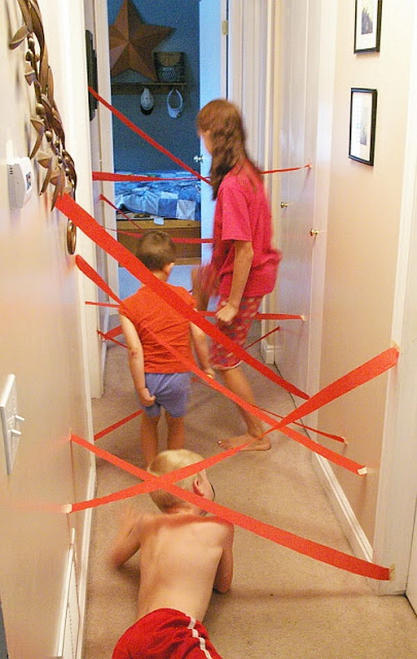 DIY Lazer Maze Kids Activity. You just need some a roll of crepe paper and some  masking tape.   Your kids  will go crazy designing mazes and working their own way through them. Learn more here.